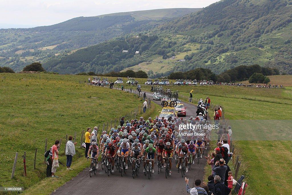 The peloton climbs towards Col de la Croix Saint-Robert during Stage 8 of the 2011 Tour de France from Aigurande to Super-Besse Sancy on July 9, 2011 in Besse-sur-Braye, France.
