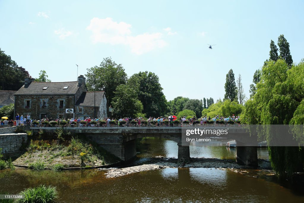 The peloton crosses a bridge during stage ten of the 2013 Tour de France, a 197KM road stage from St-Gildas-des-Bois to Saint Malo, on July 9, 2013 in St Malo, France.