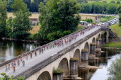 The peloton crosses La Dordogne River during stage eighteen of the 2012 Tour de France from Blagnac to BrivelaGaillarde on July 20 2012 in Souillac...