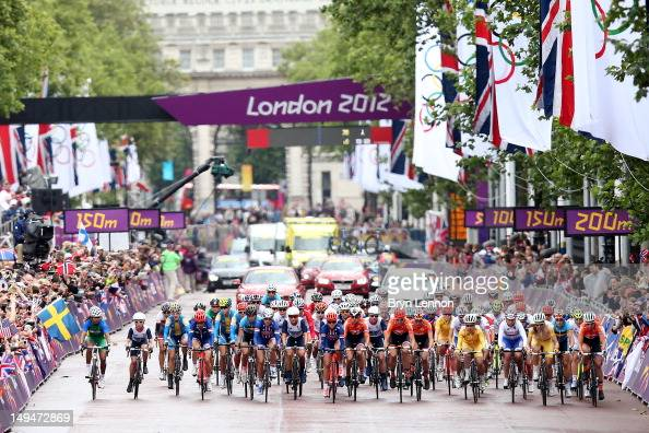 The peloton depart the Mall at the start of the Women's Road Race Road Cycling on day two of the London 2012 Olympic Games on July 29 2012 in London...