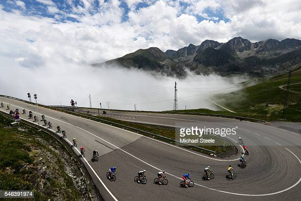 The peloton descends after the first category climb of Port d'Envalira during stage ten of the 2016 Le Tour de France a 197 km stage from...