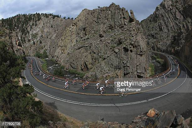 The peloton descends Big Thompson Canyon during stage six of the 2013 USA Pro Challenge from Loveland to Fort Collins on August 24 2013 in Fort...