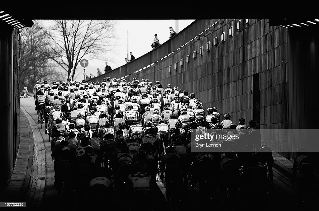 The peloton exits a tunnel at the start of the 99th Liege-Bastogne-Liege road race on April 21, 2013 in Liege, Belgium. (Photo by Bryn Lennon/Getty Images).