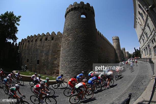 The peloton head alongside the old town in the Women's Road Race during day eight of the Baku 2015 European Games at Freedom Square on June 20 2015...
