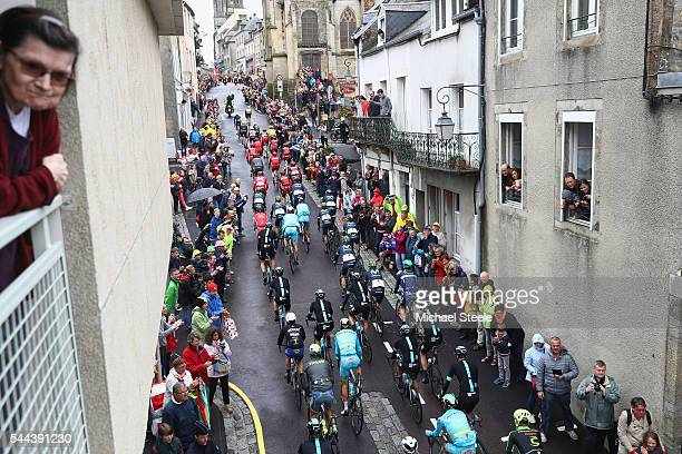 The peloton head through the town of Coutances during stage two of Le Tour de France from SaintLo to Cherbourg en Cotentin on July 3 2016 in...