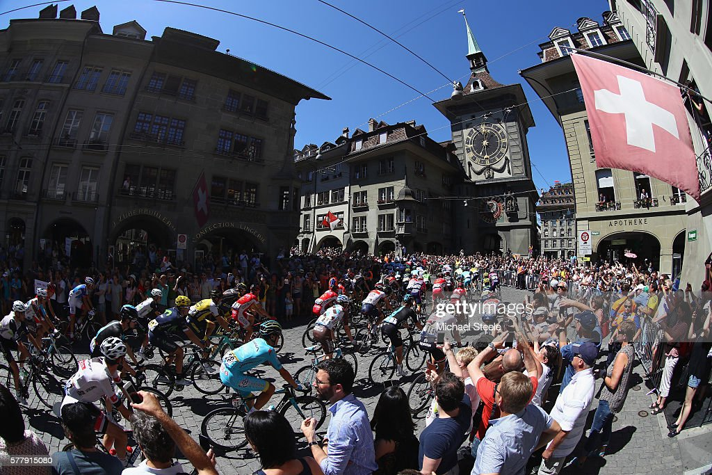 The peloton head up Kramgasse in the old town of Berne at the start of the 184.5km stage seventeen of Le Tour de France from Berne to Finhaut-Emosson on July 20, 2016 in Bern, Switzerland.