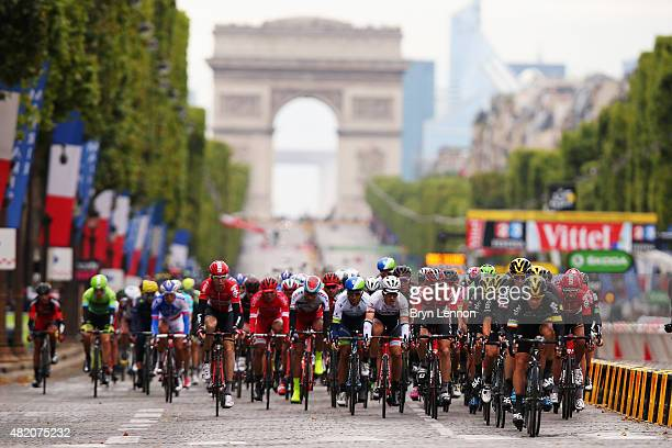 The peloton headed by riders from Team Sky ride on the Champs Elysees during the twenty first stage of the 2015 Tour de France a 1095 km stage...