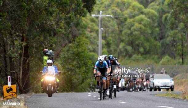 The peloton heads uphill during the king of the mountains climb during stage four of the 2017 Herald Sun Tour cycling race in Melbourne on February 5...
