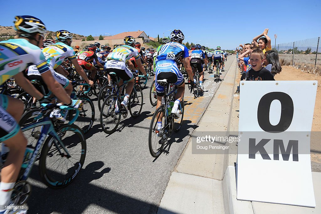 The peloton hits the 0 kilometer mark to start racing in Stage Three of the 2013 Amgen Tour of California from Palmdale to Santa Clarita on May 14, 2013 in Palmdale, California.