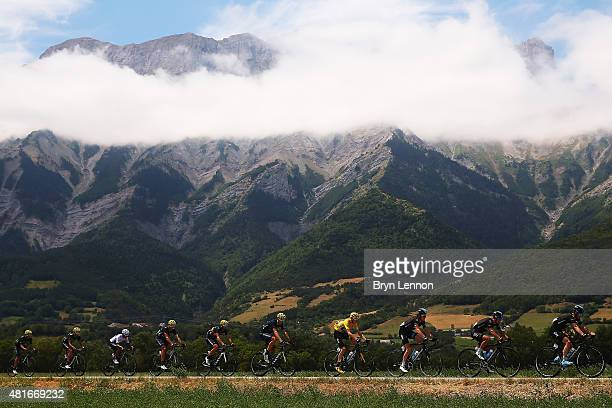 The peloton in action during Stage Eighteen of the 2015 Tour de France a 1865km stage between Gap and SaintJeandeMaurienne on July 23 2015 in...
