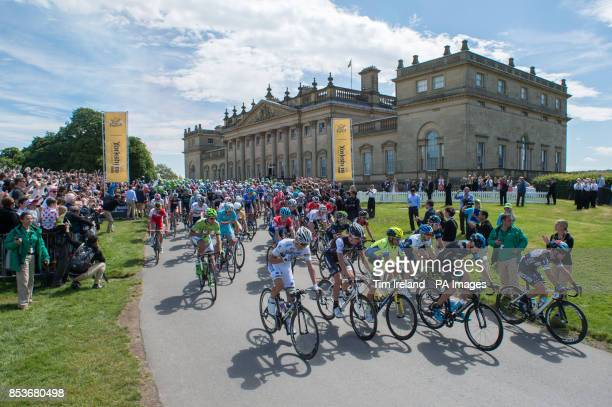 The peloton including Chris Froome and Mark Cavendish depart from Harewood House near Leeds on stage one of the Tour De France