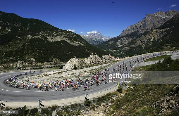 The peloton leaves Briancon during Stage 12 of the 92nd The Tour de France between Briancon and DigneLesBains on July 14 2005 in Briancon France
