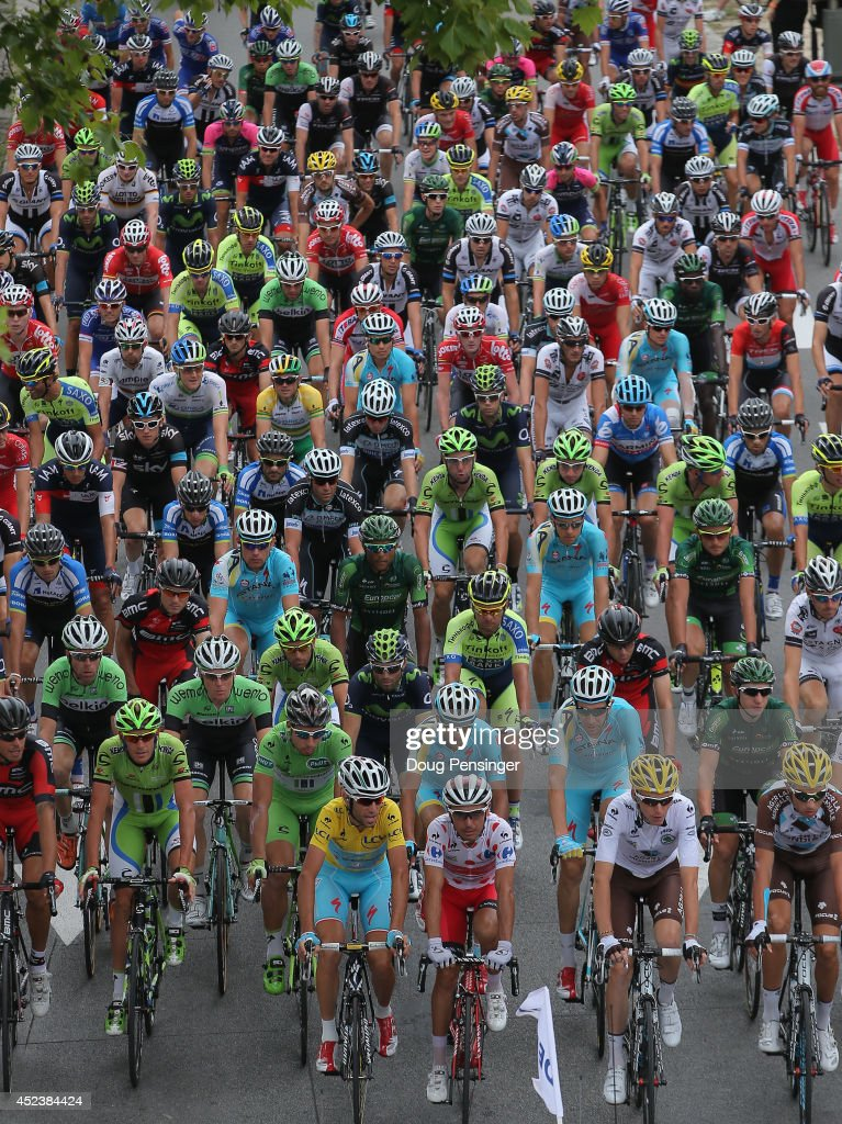 The peloton leaves the start for the fourteenth stage of the 2014 Tour de France, a 177km stage between Grenoble and Risoul, on July 19, 2014 in Grenoble, France.