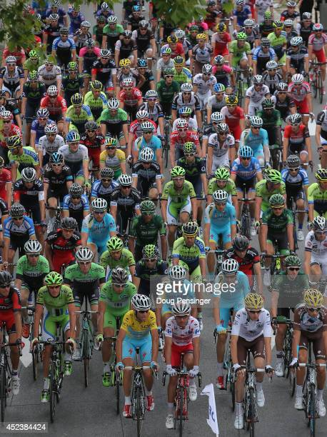 The peloton leaves the start for the fourteenth stage of the 2014 Tour de France a 177km stage between Grenoble and Risoul on July 19 2014 in...