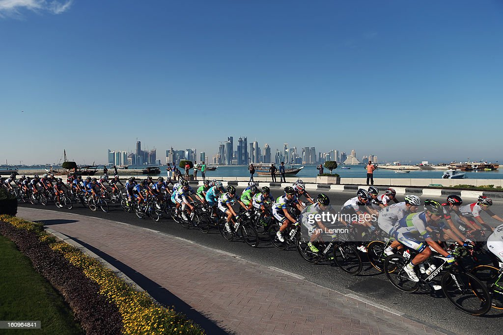The peloton make their way along the Doha Corniche during stage six of the 2013 Tour of Qatar from Sealine Beach Resort to Doha Corniche on February 8, 2013 in Doha, Qatar.