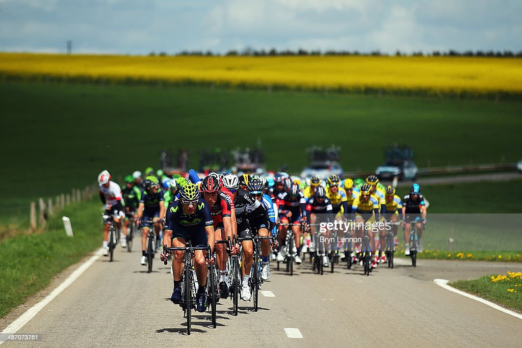 The peloton make their way through the Belgian countryside during the 100th edition of the LiegeBastogneLiege road race on April 27 2014 in Liege...