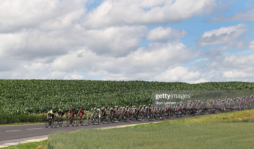 The peloton make their way through the French Countryside during stage seven of the 2012 Tour de France from Tomblaine to La Planche des Belles...