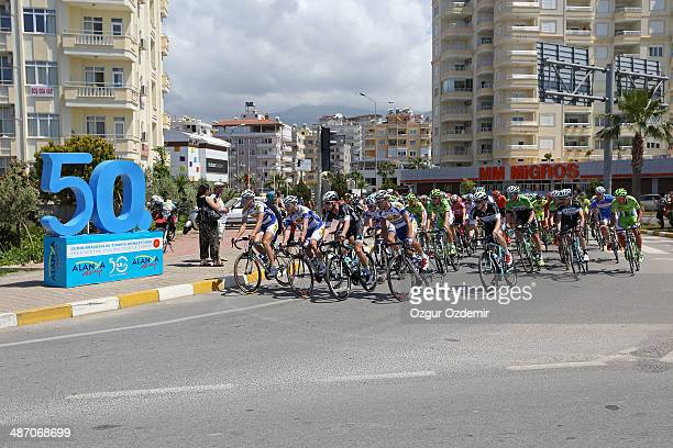 The peloton make their way through the Mediterranean resort town of Alanya during the first stage of the Presidencial Cycling Tour of Turkey on April...