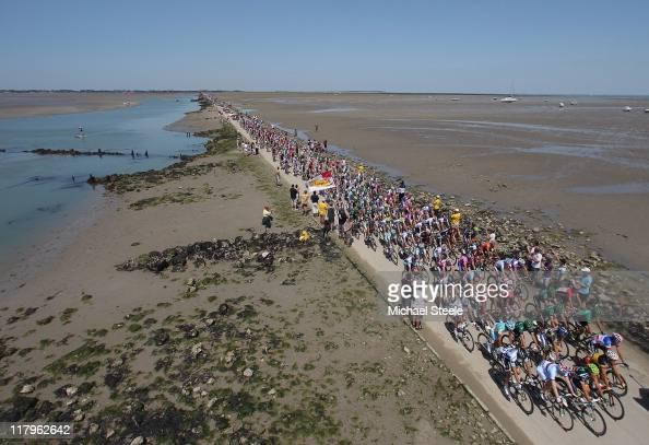 The peloton makes its way across the Passage du Gois during stage one of the 2011 Tour de France from Passage du Gois to Mont des Alouettes Les...