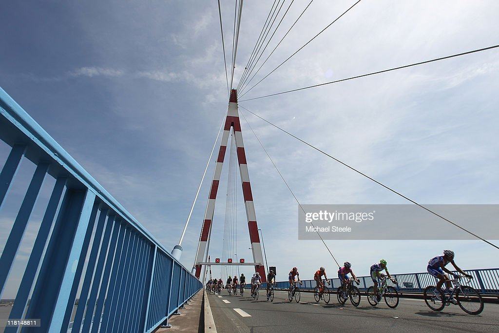 The peloton makes its way over a bridge towards St Nazaire during Stage 3 of the 2011 Tour de France from Olonne sur Mer to Redon on July 4, 2011 in Redon, France.