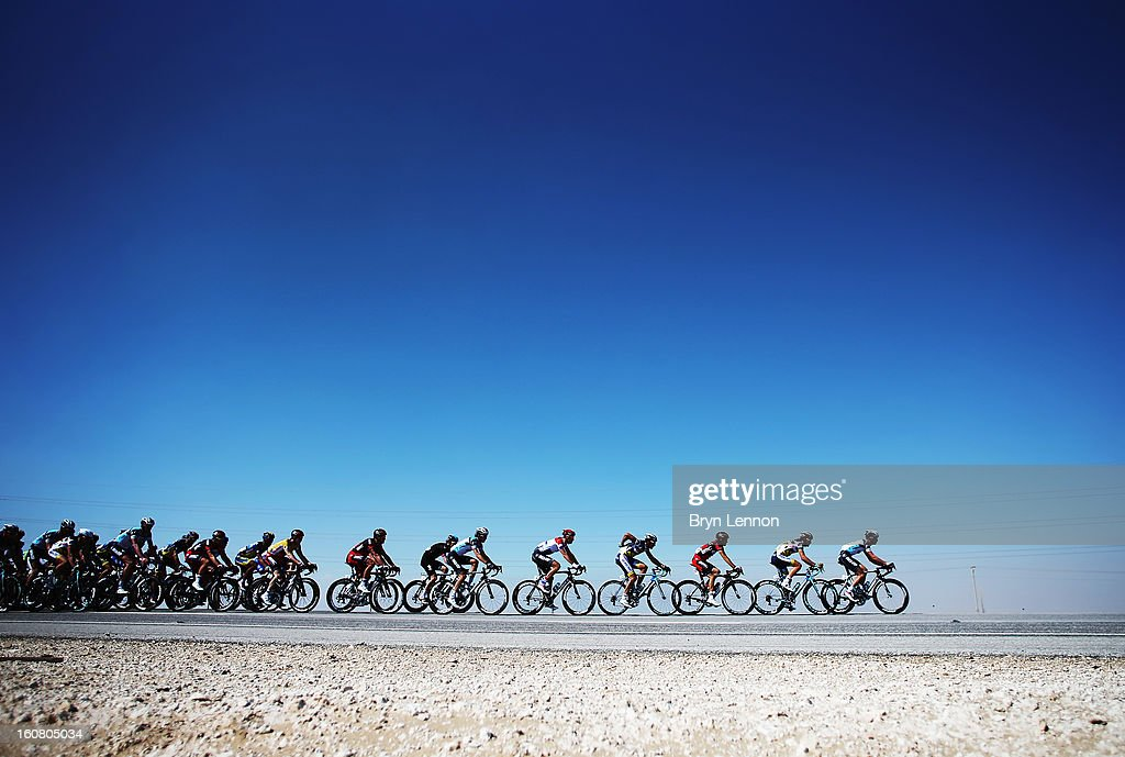 The peloton makes its' way through the Qatar desert on stage four of the Tour of Qatar from Camel Race Track to Al Khor Corniche on February 6, 2013 near Camel Race Track, Qatar.