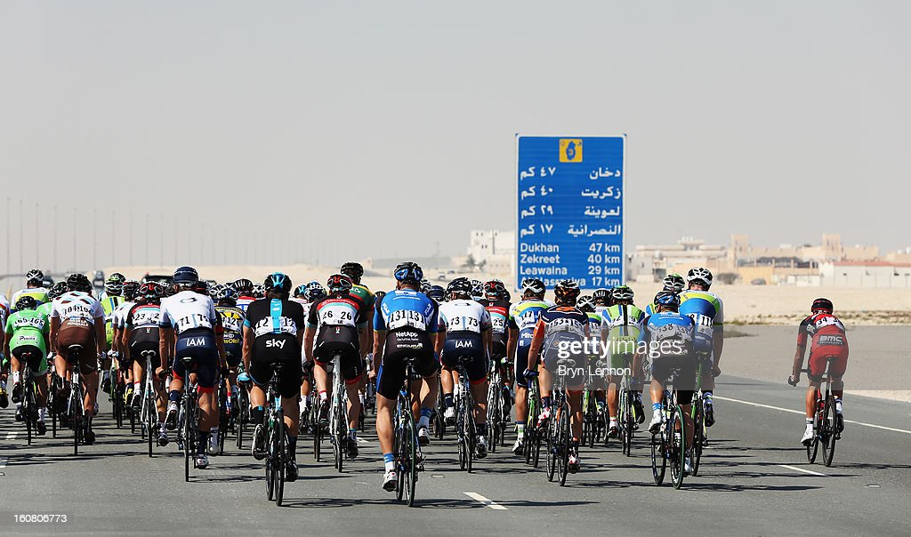 The peloton makes its way through the Qatar desert on stage four of the Tour of Qatar from Camel Race Track to Al Khor Corniche on February 6, 2013 near Camel Race Track, Qatar.