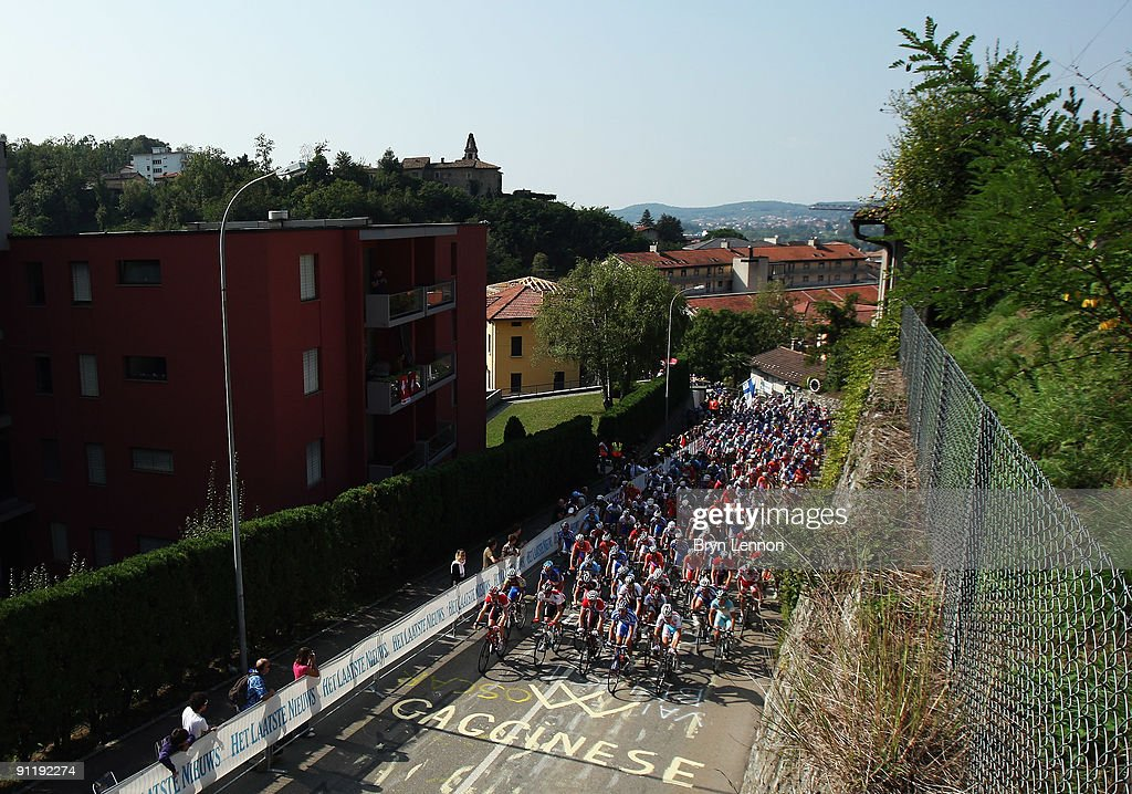 The peloton makes its way through the streets of Mendrisio on the Men's Road Race at the 2009 UCI Road World Championships on September 27, 2009 in Mendrisio, Switzerland.