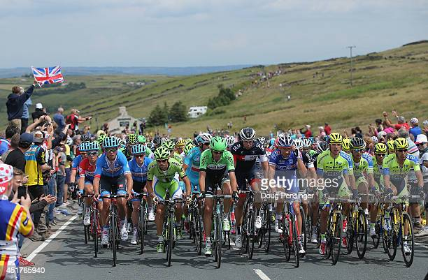 The peloton makes the claim of the Cote d'Oxenhope Moor during stage two of the 2014 Le Tour de France from York to Sheffield on July 6 2014 in...