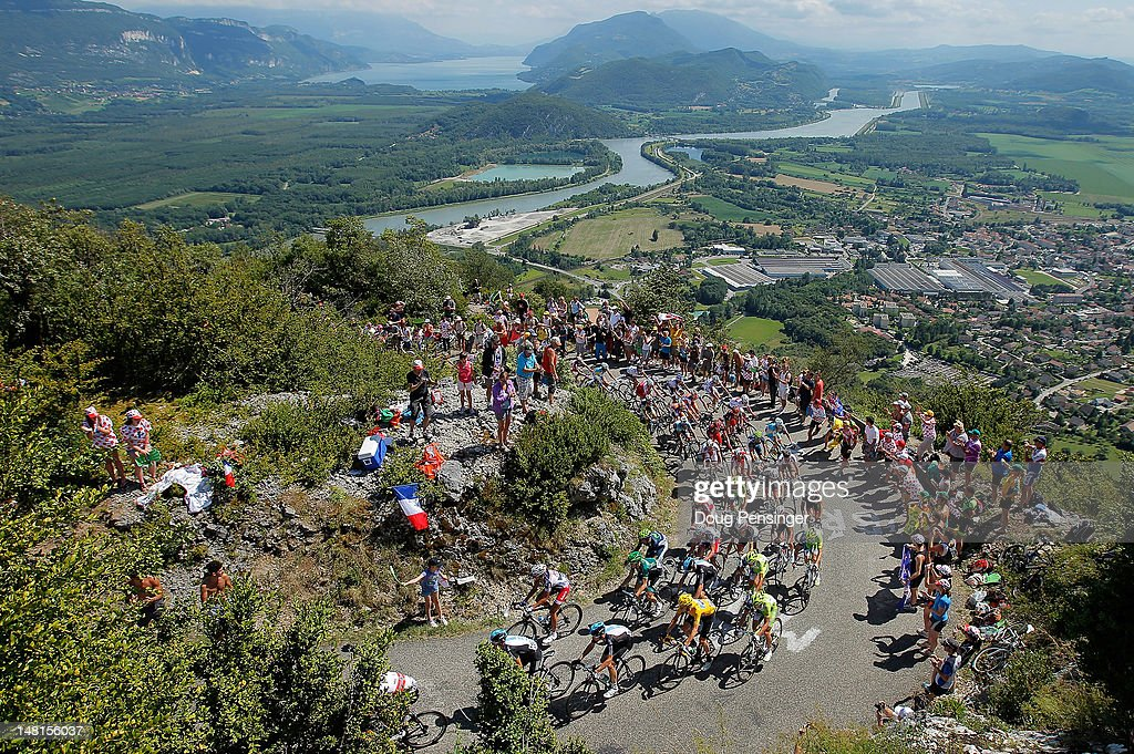 The peloton makes the climb of the Col du Grand Columbier with <a gi-track='captionPersonalityLinkClicked' href=/galleries/search?phrase=Bradley+Wiggins&family=editorial&specificpeople=182490 ng-click='$event.stopPropagation()'>Bradley Wiggins</a> of Great Britian riding for Sky Procycling in the race leader's yellow jersey during stage ten of the 2012 Tour de France from Macon to Bellegarde-Sur-Valserine on July 11, 2012 in La Sapette, France.