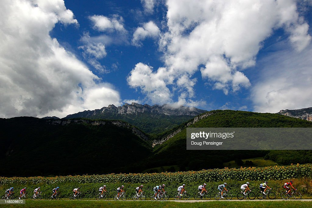 The peloton makes their way between first category climbs during stage twelve of the 2012 Tour de France from Saint-Jean de Maurienne to Annonay on July 13, 2012 in Chapareillan, France.