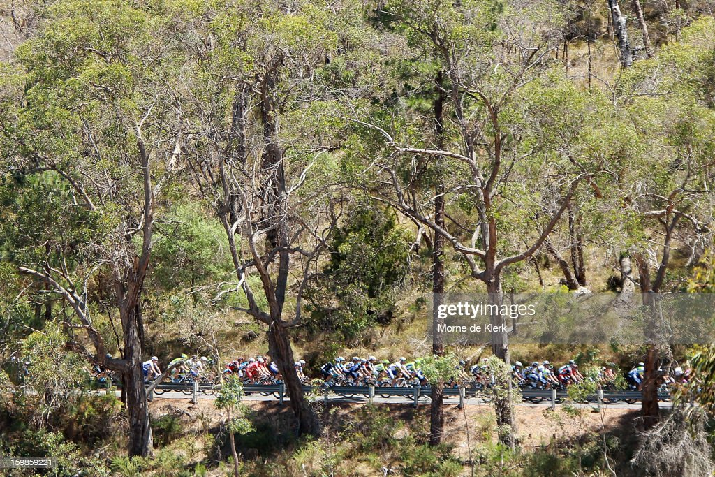 The peloton moves through the hills during stage 1 of the Tour Down Under bicycle race between Prospect and Lobethal in the Adelaide Hills on January 22, 2013 in Adelaide, Australia.