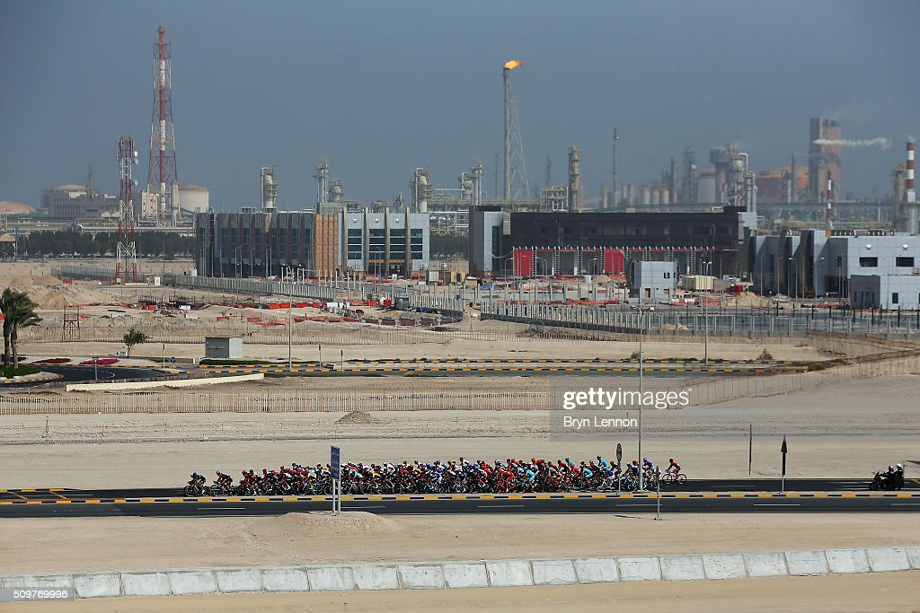 The peloton pass a refinery during stage five of the 2016 Tour of Qatar, a 114.5km road stage from Sealine Beach Resort to Doha Corniche, on February 12, 2016 in Doha, Qatar