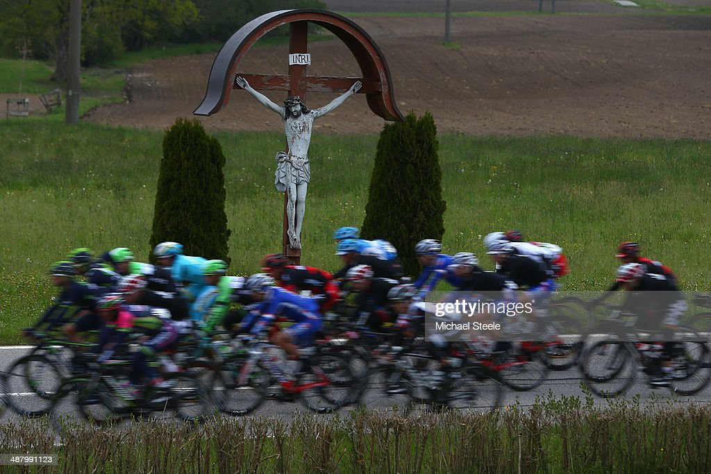 The peloton pass a statue of Jesus Christ during stage four of the Tour de Romandie from Fribourg to Fribourg on May 3, 2014 in Fribourg, Switzerland.