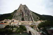 The peloton pass through Sisteron during the fifteenth stage of the 2014 Tour de France a 222km stage between Tallard and Nimes on July 20 2014 in...