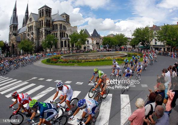 The peloton passes a cathedral during stage six of the 2012 Tour de France from Epernay to Metz on July 6 2012 in Chalons France