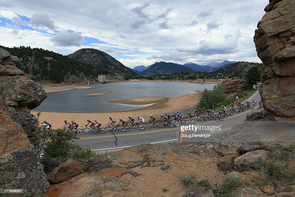 The peloton passes a reservoir during stage six of the 2013 USA Pro Challenge from Loveland to Fort Collins on August 24 2013 in Estes Park Colorado