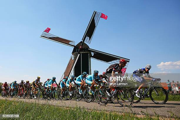 The peloton passes a windmill during stage two of the 2016 Giro d'Italia a 190km stage from Arnhem to Nijmegen on May 07 2016 in Nijmegen Netherlands
