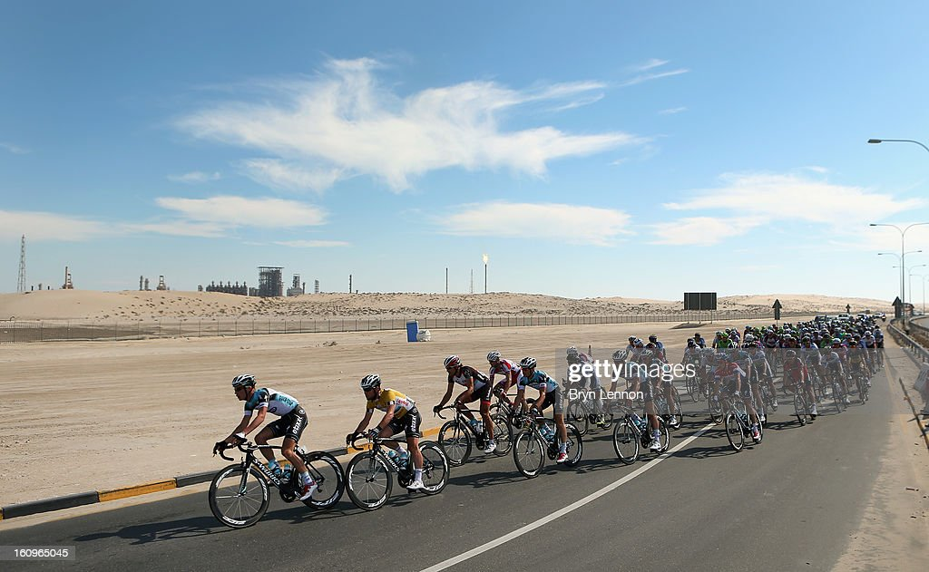 The peloton passes an oil refinery during stage six of the 2013 Tour of Qatar from Sealine Beach Resort to Doha Corniche on February 8, 2013 near Sealine Beach Resort, Qatar.