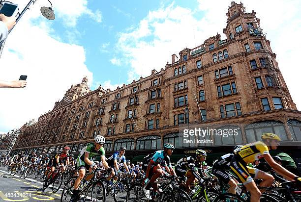 The peloton passes Harrods during the Prudential RideLondon Surrey Classic on August 10 2014 in London England