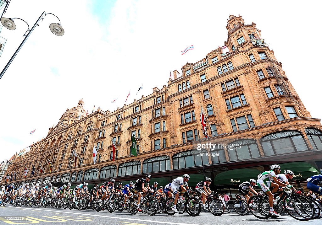 The peloton passes Harrods during the Prudential RideLondon-Surrey Classic race on August 4, 2013 in London, England.