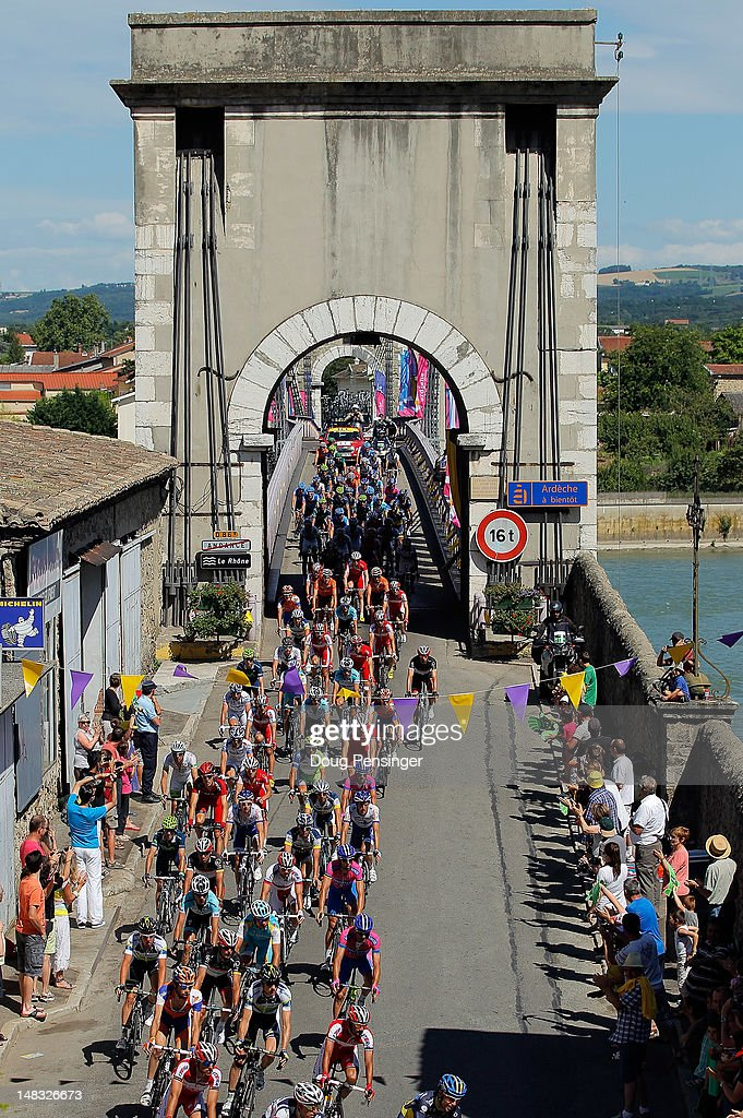 The peloton passes over Le Rhone river during stage twelve of the 2012 Tour de France from Saint-Jean de Maurienne to Annonay on July 13, 2012 in Andance, France.