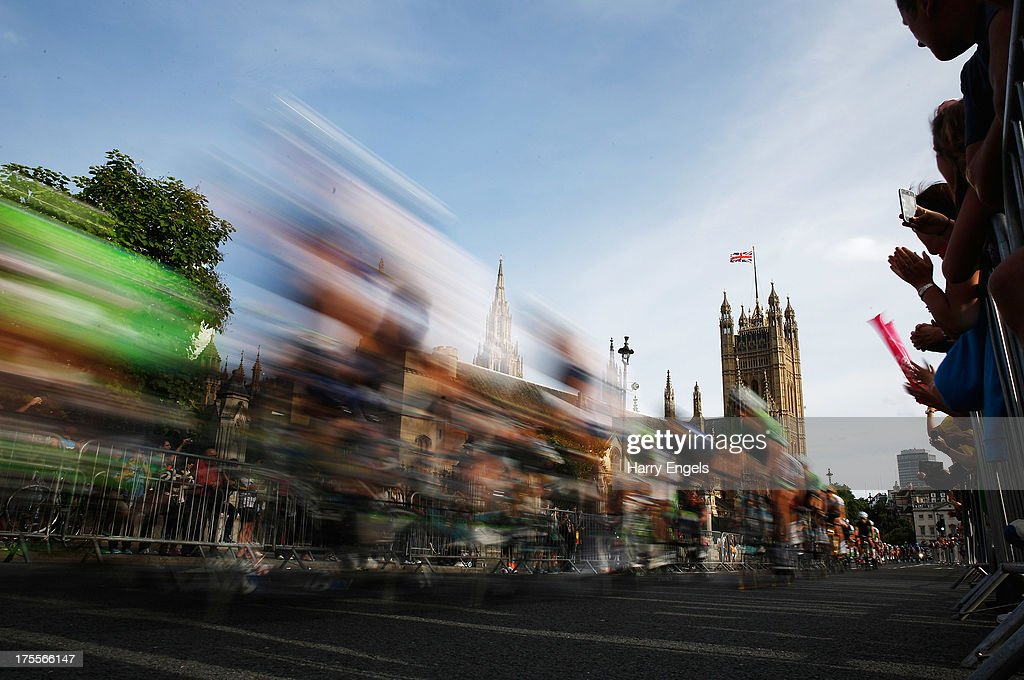 The peloton passes the Houses of Parliament during the Prudential RideLondon-Surrey Classic on August 4, 2013 in London, England.