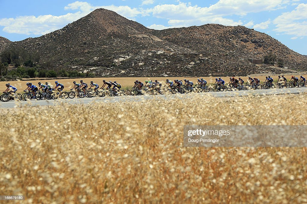 The peloton passes through a wheat field during Stage Two of the 2013 Amgen Tour of California from Murrieta to Palm Springs on May 13, 2013 in Hemet, California.