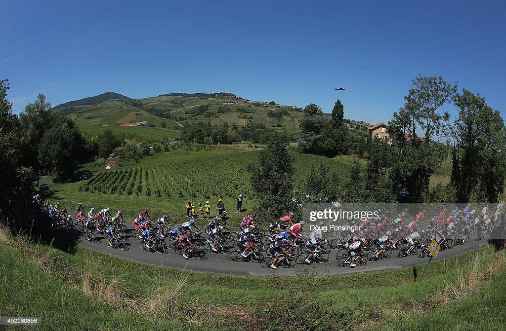 The peloton passes through beaujolais vineyards during the twelfth stage of the 2014 Tour de France, a 186km stage between Bourg-en-Bresse and Saint-Etienne, on July 17, 2014 in Cogny, France.