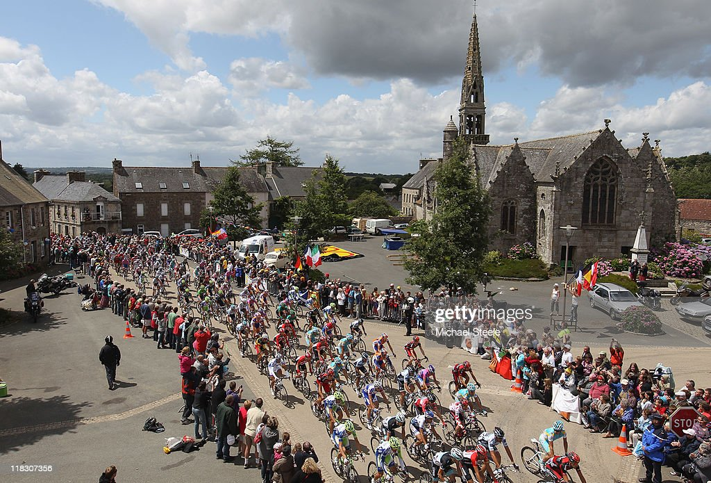 The peloton passes through La Chapelle Neuve during Stage 5 of the 2011 Tour de France from Carhaix to Cap Frehel on July 6, 2011 in Cap Frehel, France.