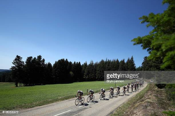 The peloton passes through the French countryside on stage sixteen of the 2017 Tur de France a 165km road stage from Le Puy enVelay to RomanssurIsere...