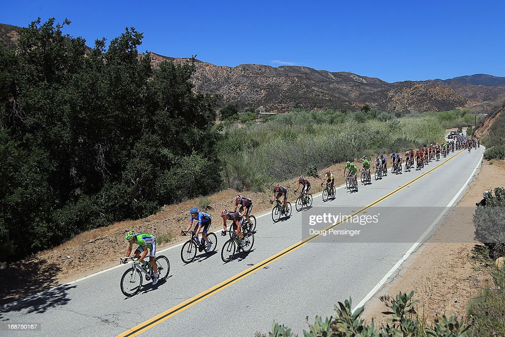The peloton passes through the mountains during Stage Three of the 2013 Amgen Tour of California from Palmdale to Santa Clarita on May 14, 2013 in Santa Clarita, California.