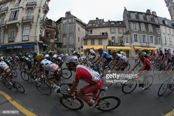 The peloton passes through the street of Pau as they begin the eighteenth stage of the 2014 Tour de France a 146km stage between Pau and Hautacam on...