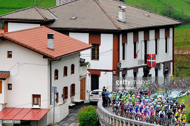 The Peloton passes through the village of Elduaien during the Stage Two of Vuelta al Pais Vasco between Ordizia and Urdax on April 8 2014 in Urdax...