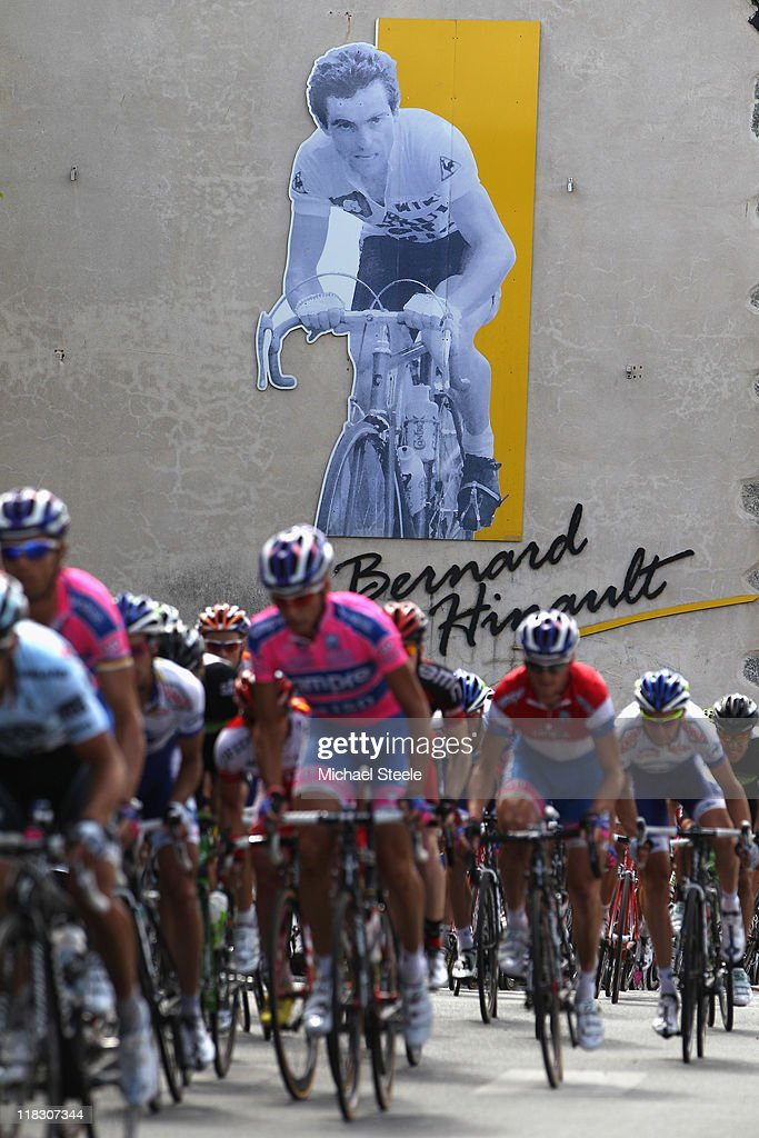 The peloton passes through Yffiniac the home town of racing legend <a gi-track='captionPersonalityLinkClicked' href=/galleries/search?phrase=Bernard+Hinault&family=editorial&specificpeople=749939 ng-click='$event.stopPropagation()'>Bernard Hinault</a> during Stage 5 of the 2011 Tour de France from Carhaix to Cap Frehel on July 6, 2011 in Cap Frehel, France.